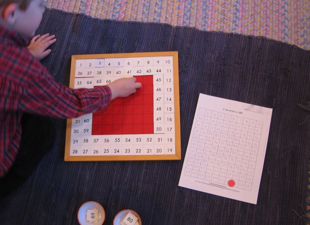 a child completing the Hundred Board math activity